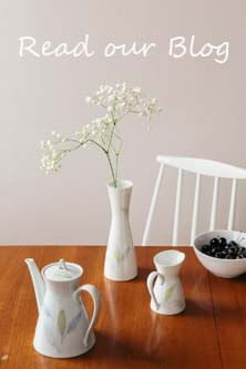 Breakfast table with tea pot and vase of flowers - Read our blog